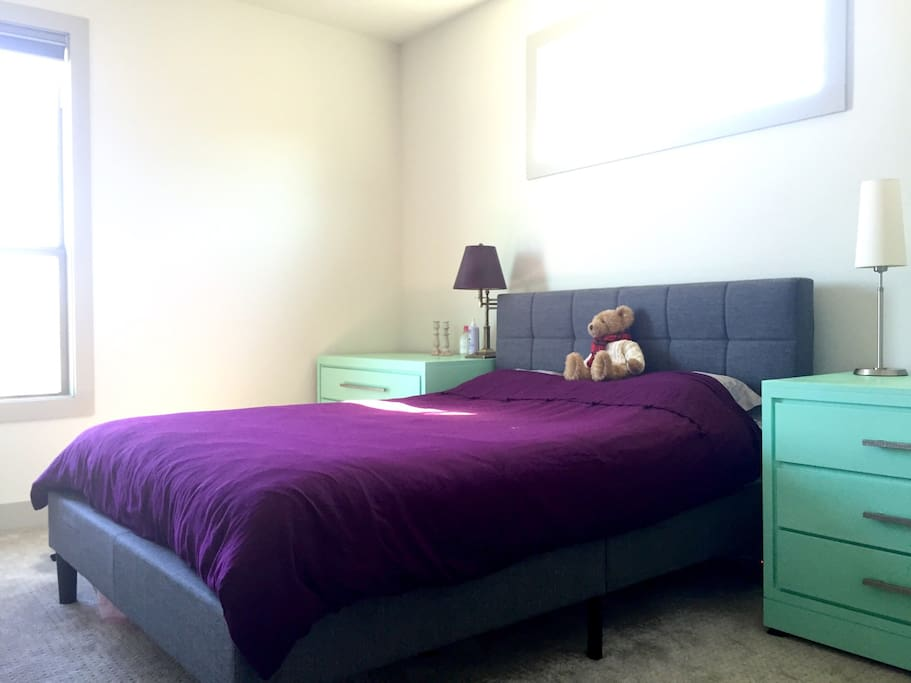 Private bedroom upstairs with a queen size bed that comfortably sleeps two!