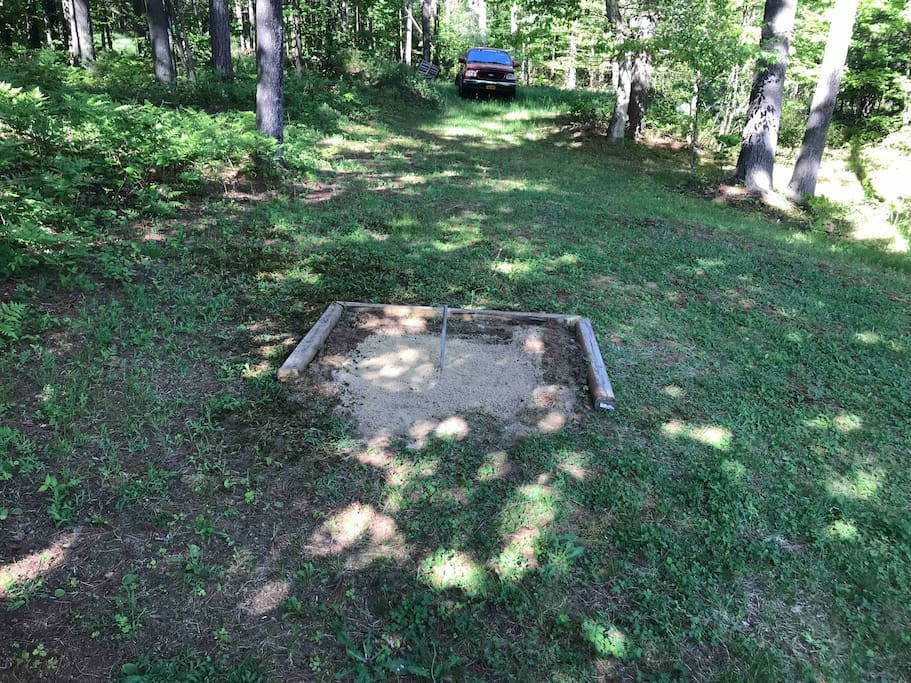 Horseshoe pit on the side of house
