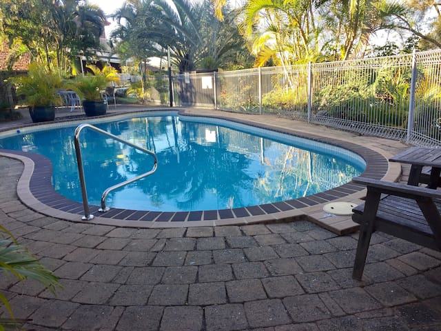 Communal Pool - Peaceful and tranquil swimming pool looking out to the lake.  Includes chairs and sunbeds.  Pool is shared with only 11 other townhouses so most of the time you will have the pool to yourself.  Pool is just 30 meters from the property