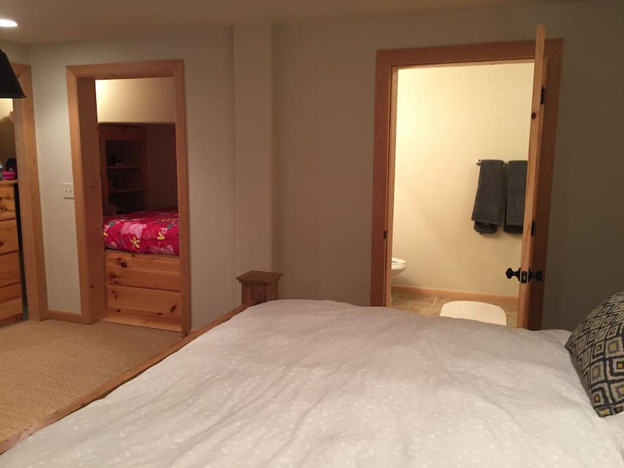 View of bedroom showing en-suite bathroom and nest with a bed, perfect for kids.