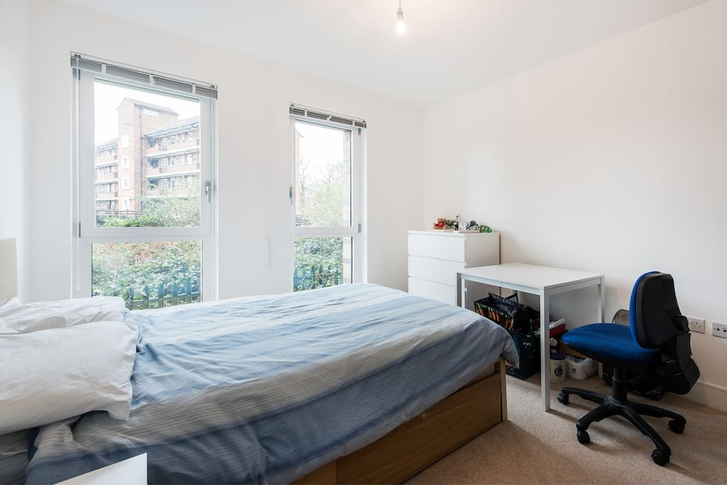 Clean, spacious bedroom complete with double bed, office desk & chair and privacy blinds.