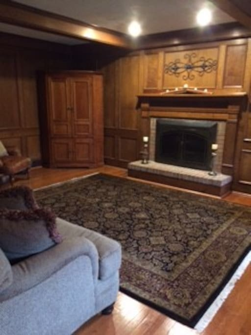 Family room with gas fireplace and TV
