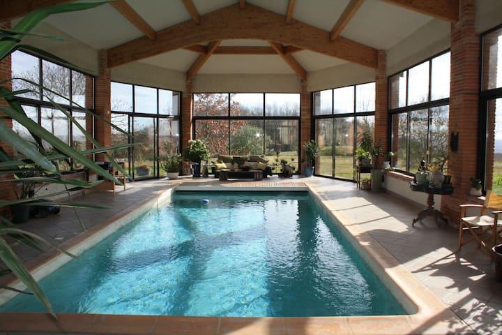 Au calme, la nature et la piscine chauffée