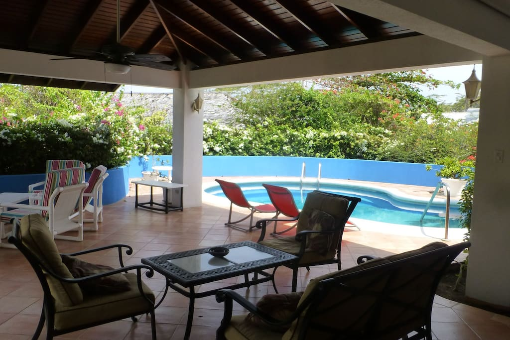 Large covered patio ideal for al fresco dining. lounging by the pool!