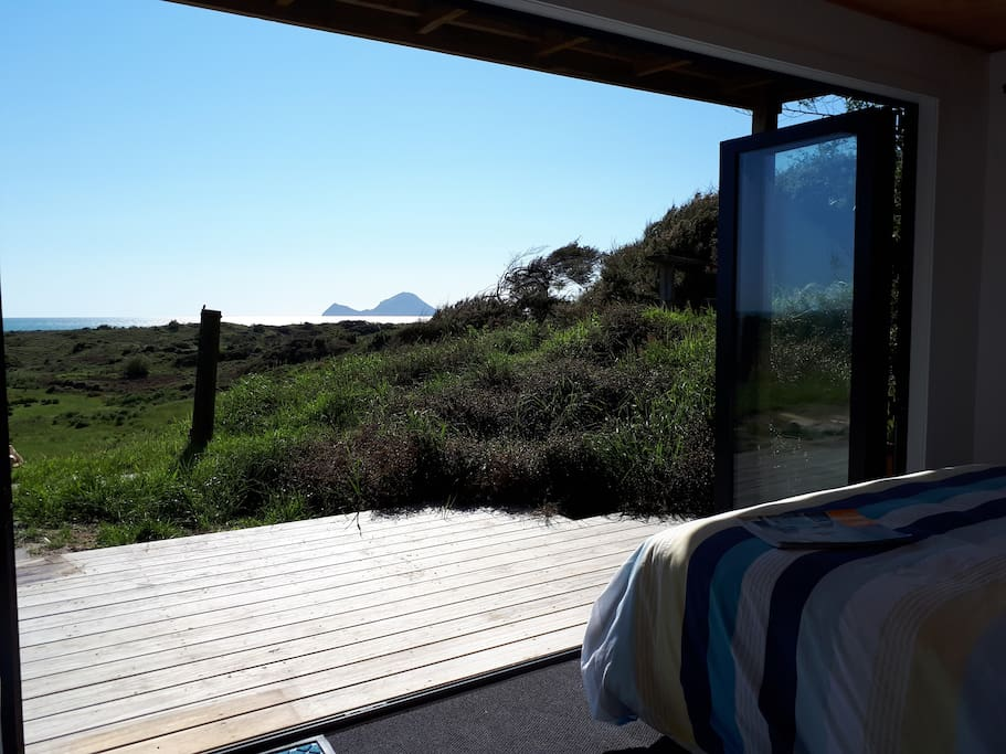 Wake up to spectacular views from bed....straight out to white island.