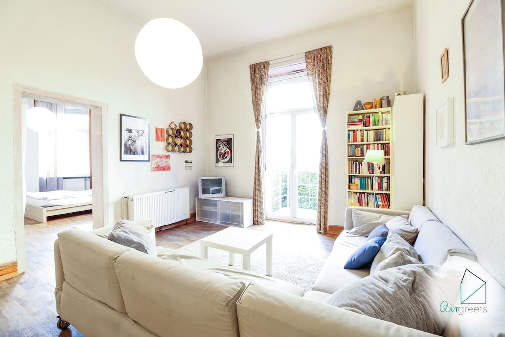The living room is spacious and has a cozy atmosphere.