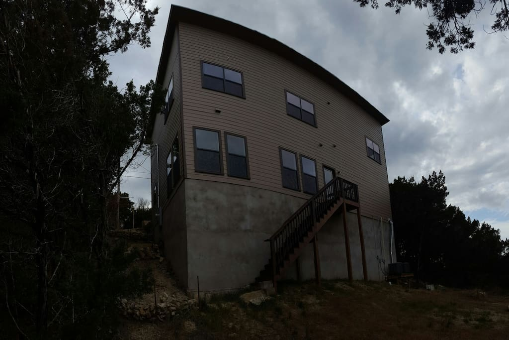 Rear of home, access to greenbelt trails. 40 foot foundation gives you great Austin Hill Country views.