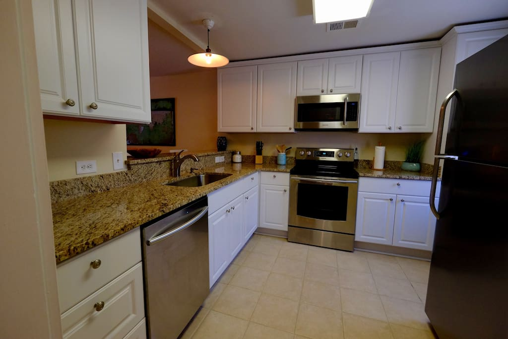 Granite counter tops, new stainless appliances, and a fully stocked kitchen await your culinary skills.