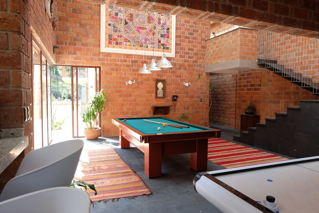 Living room with pool and air-hockey tables