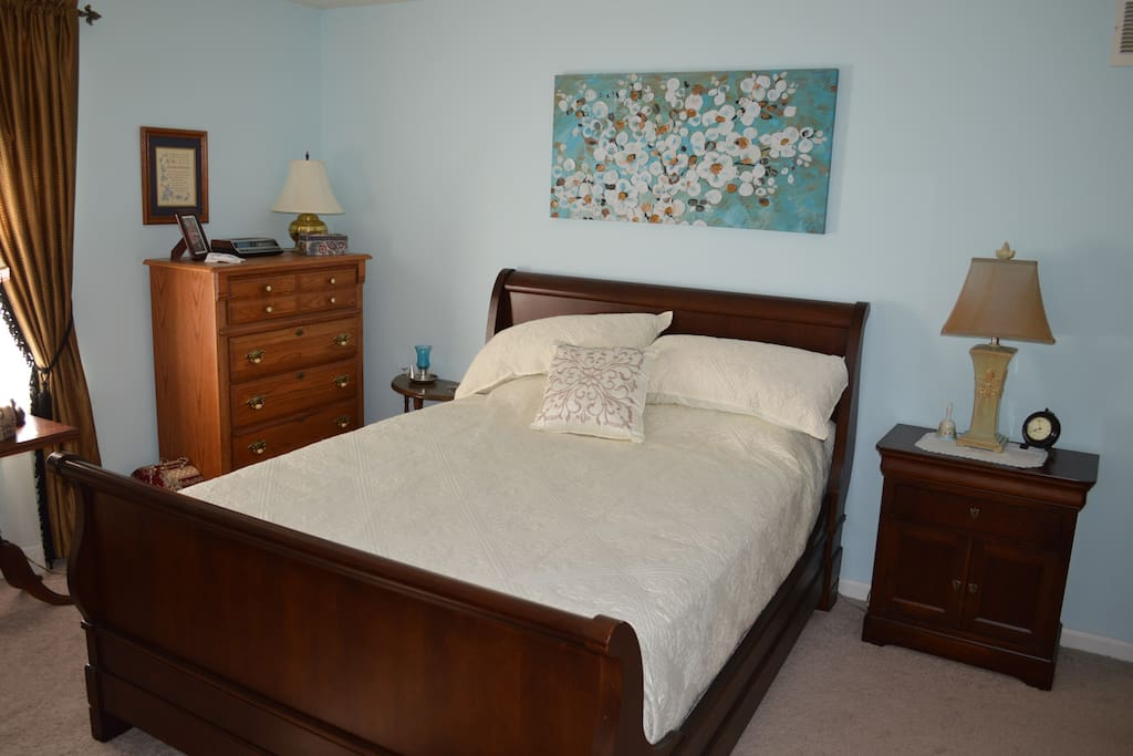 Queen size bed  in  guest bedroom