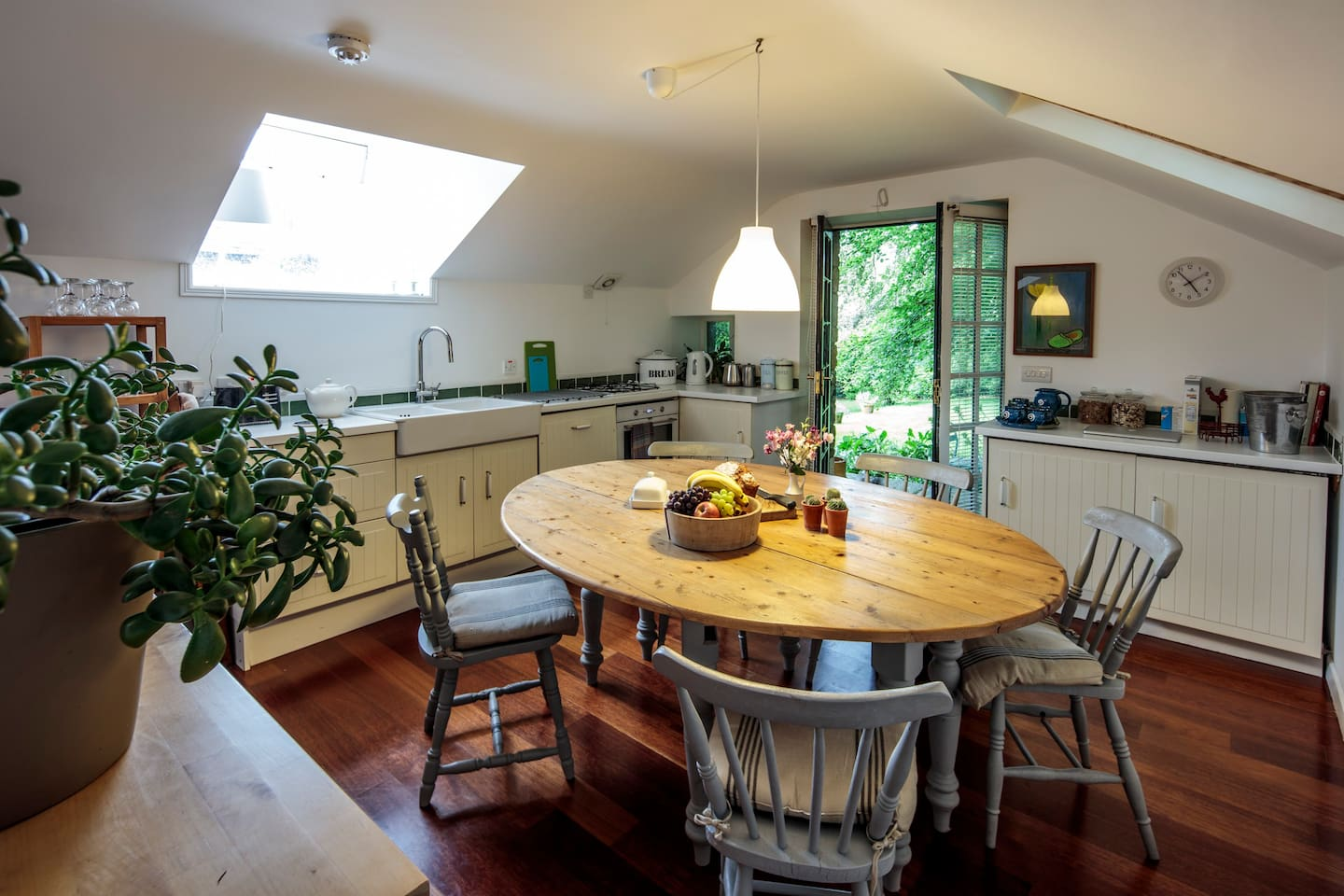Open plan kitchen dining area with French doors to the garden