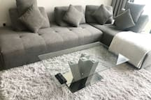 Contemporary corner sofa. Convertible into a queen size bed when cushions are removed and right hand part of the sofa is moved parallel to the left hand side. Extra sheets will be provided