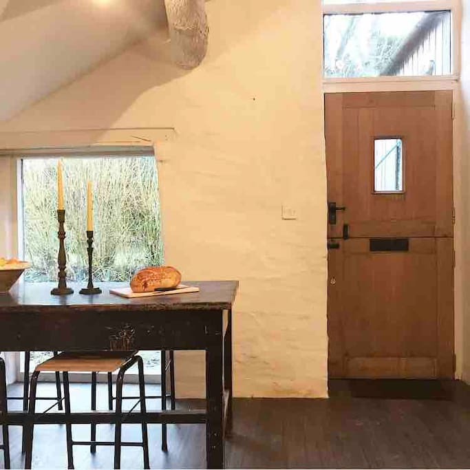 One end of the kitchen, with a big window looking out to the garden and a table for food preparation and drinking wine whilst chatting to the chef!
