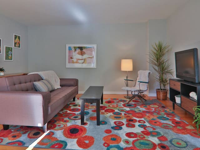Cheerful living room with cable TV