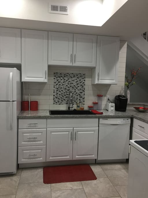 Full, private kitchen with full size oven, fridge, dishwasher, and microwave.