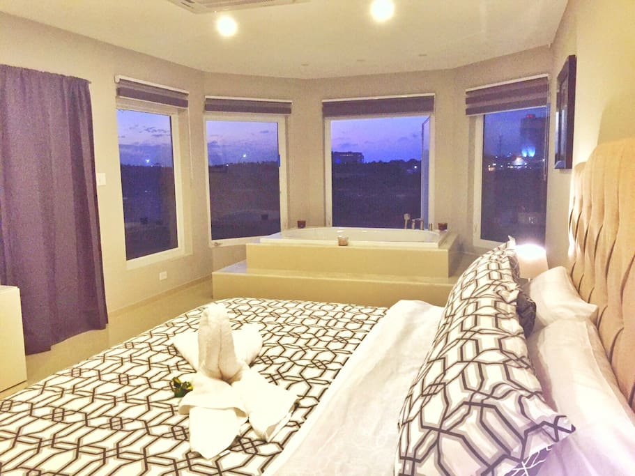 Master Suite second floor  with Jacuzzi , Private Bathroom and Walk in Closet and private access to balcony