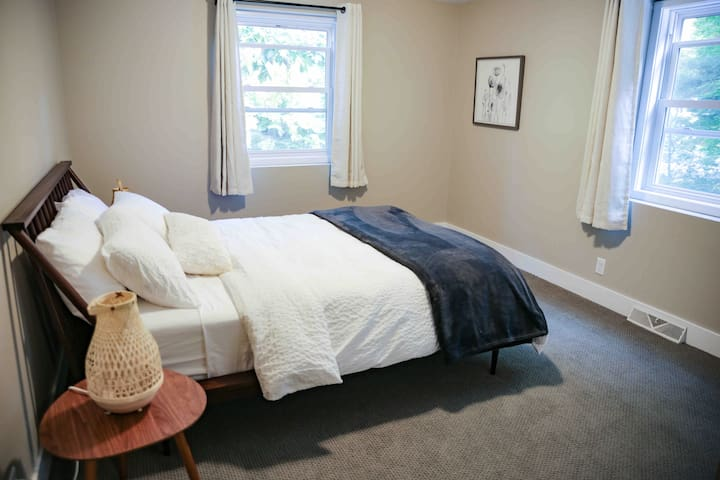 Bedroom 1 (sleeps up to 2): 1 queen bed, night stands, blackout curtains