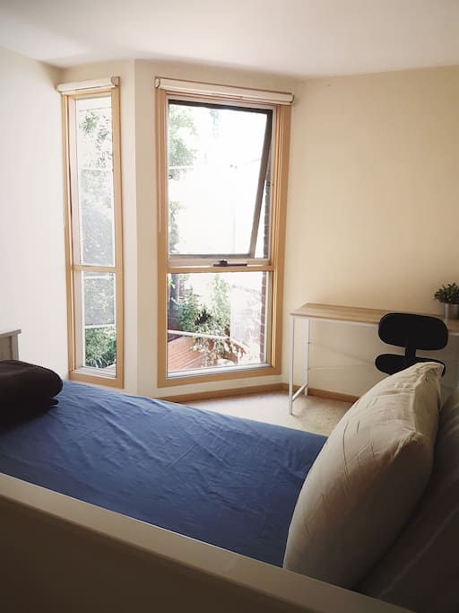 Double sized room with natural light. Windows do have block out blinds.