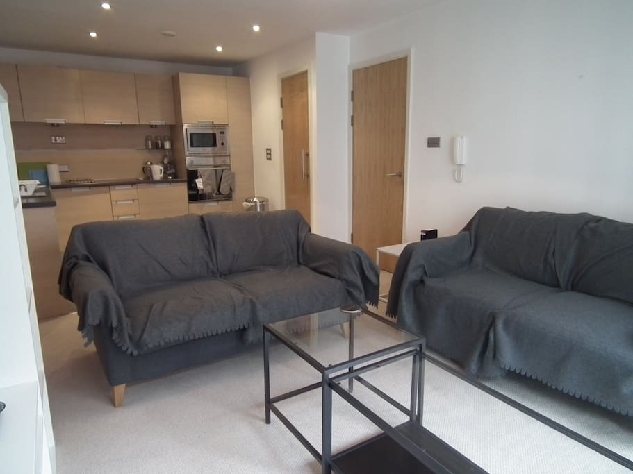 """Living room, two double sofas and two coffee tables overlooking 32"""" TV with Sky TV"""
