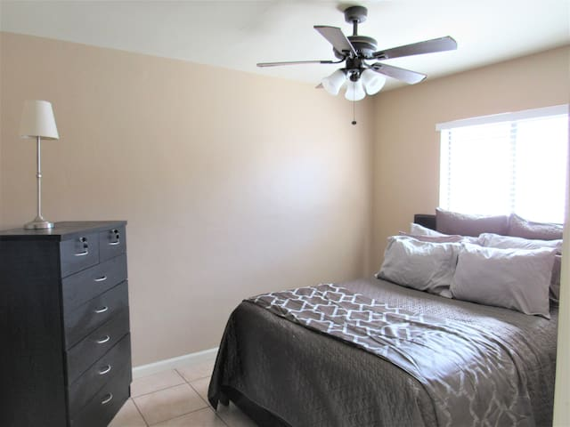The bedroom has a comfortable Queen Size Bed and great bedding! We also added a TV to this bedroom!