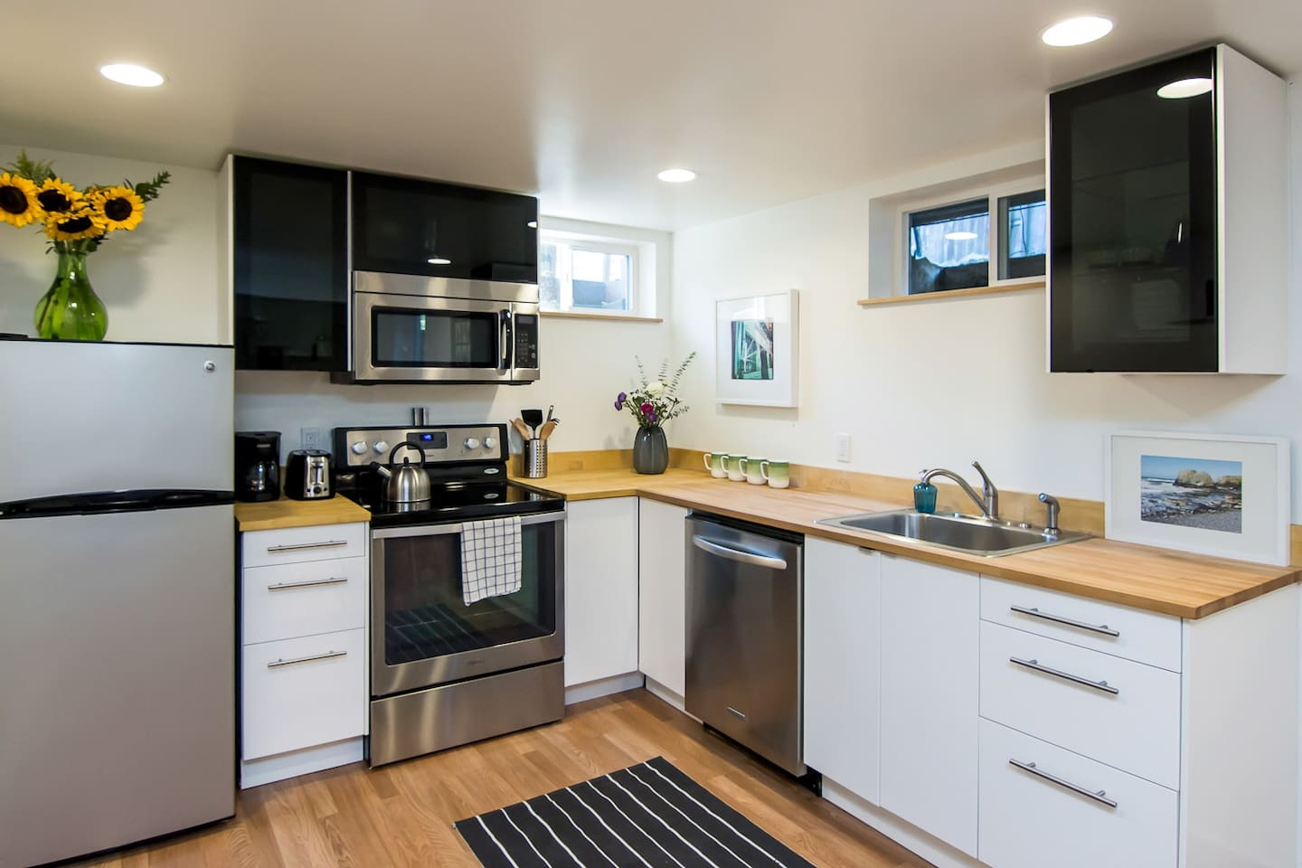 Brand new modern kitchen. Butcher block counter tops and all new stainless steal appliances.