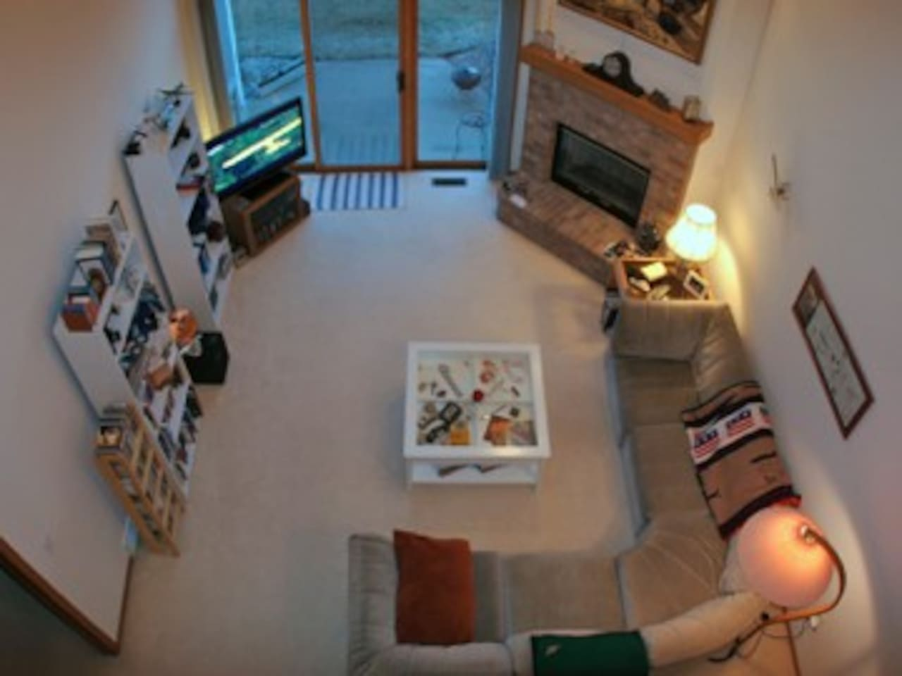 The view of the living room from the loft. The upstairs loft can accommodate a pair of guests on their own bedding.