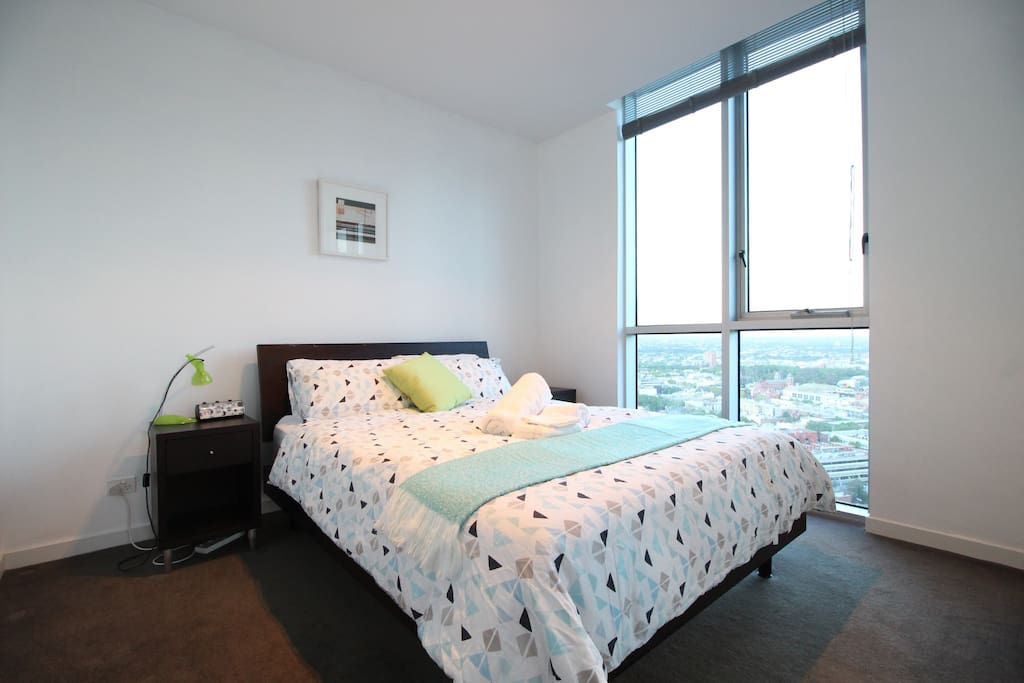 Spacious bedroom 2 with floor to ceiling windows