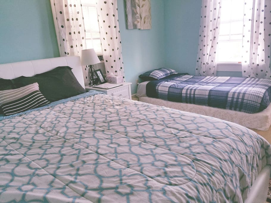 Pillowtop queen bed and separate twin bed in one bedroom