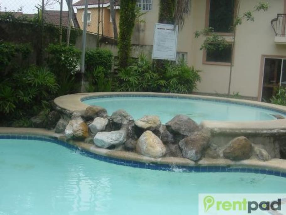 OUR POOL AND YOU SEE THE KIDDIE POOL
