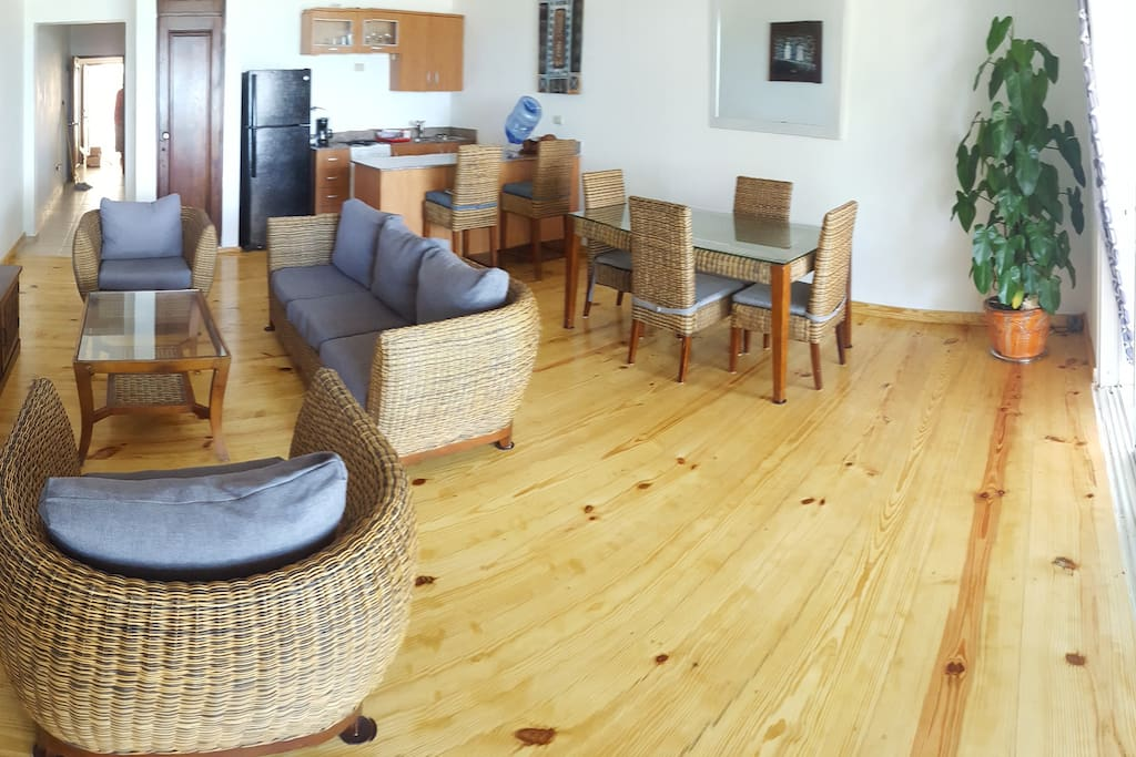 Stunning, large, light and airy living room with flat screen TVm comfy sofas, dining table & open plan kitchen