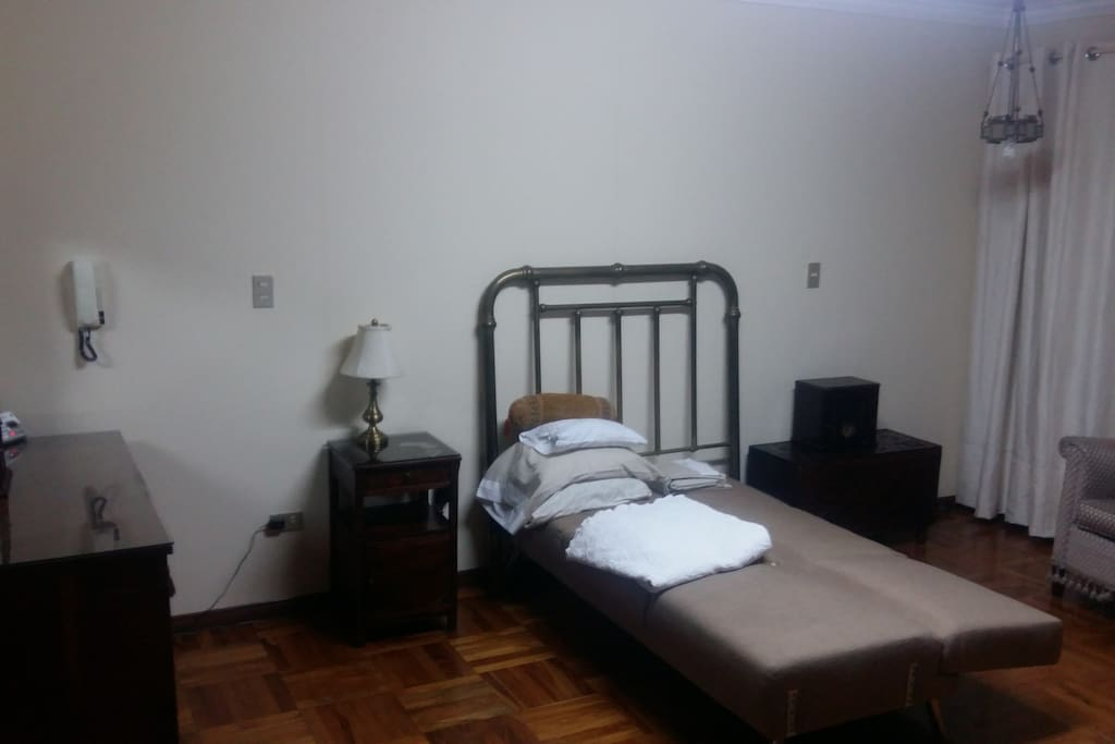 Main bedroom with in suite bathroom with bath tub, seating area and balcony