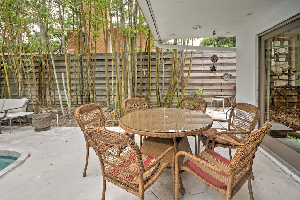 The private backyard with an abundance of Bamboo and lush gardens is the perfect place to enjoy meals al fresco.