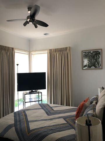 Bedroom 2  Double size bed Spacious glass door wardrobe Modern room set up Street view Blackout curtain and blinds
