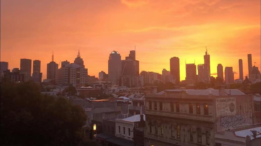 Fitzroy apartment room with view of CBD