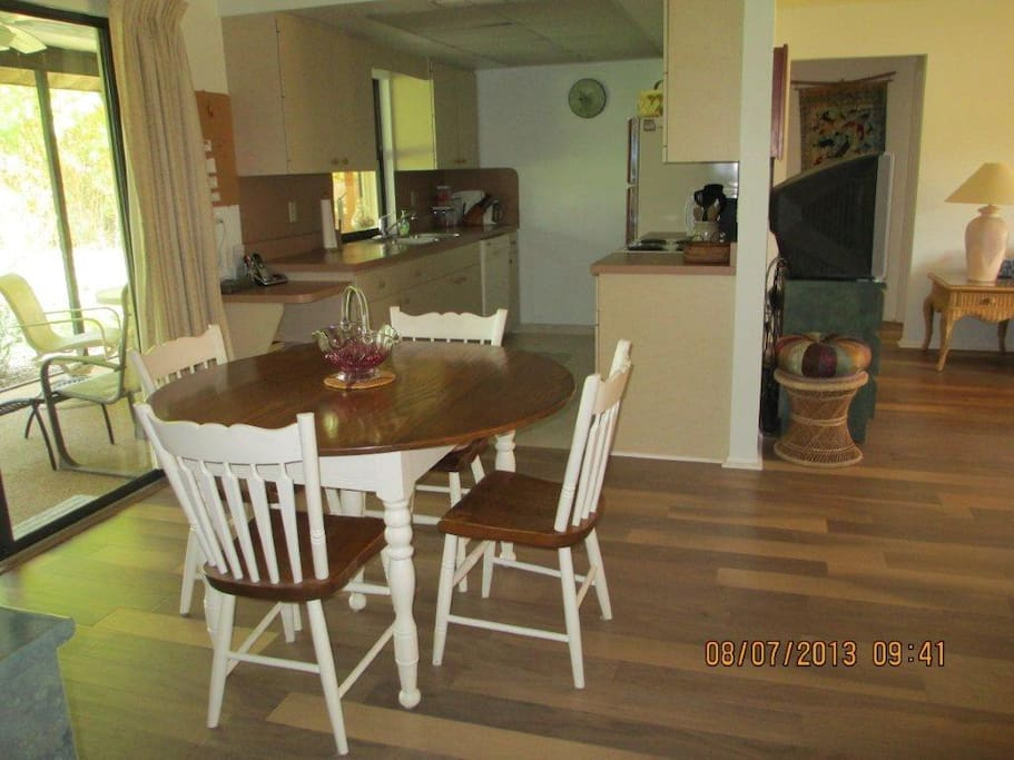 The kitchen is fully furnished, including a new stove and refrigerator. The table expands to seat 10.