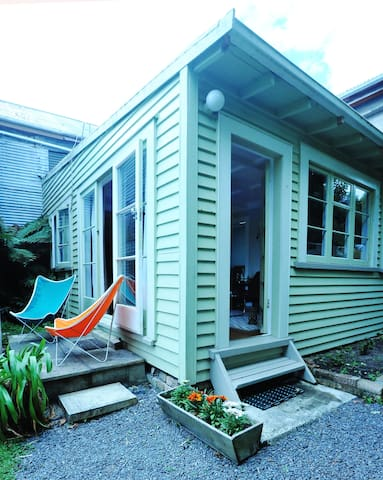 Cottage exterior with Butterfly chairs.