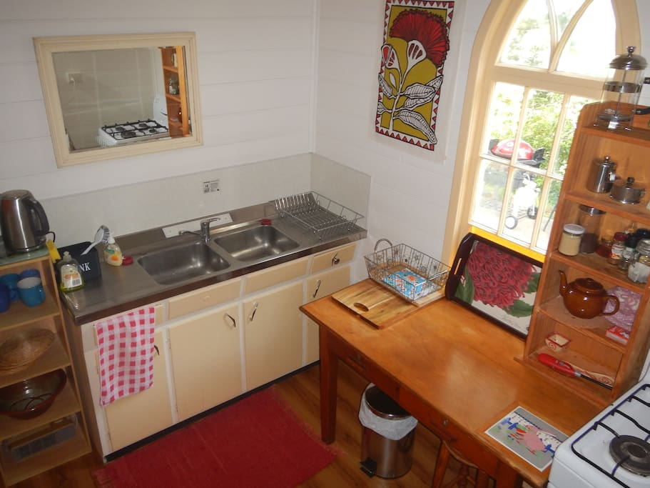 Cute well equiped kitchen with gas stove.