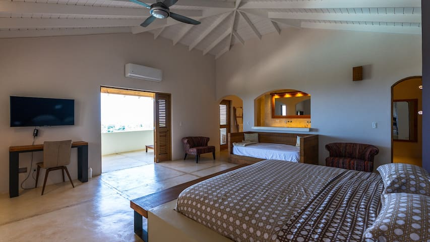 Masterbedroom with king, extra small sofa bed, bathroom, (shower, sinks and toilet), AC, balcony and jacuzzi.