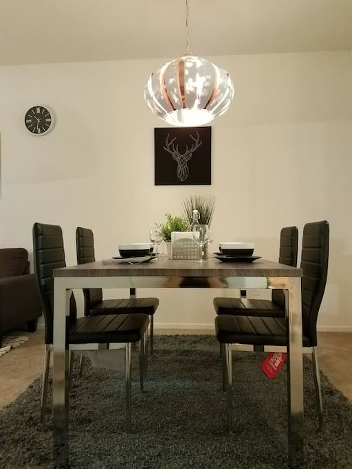 spacious dining table accommodating up to four guests