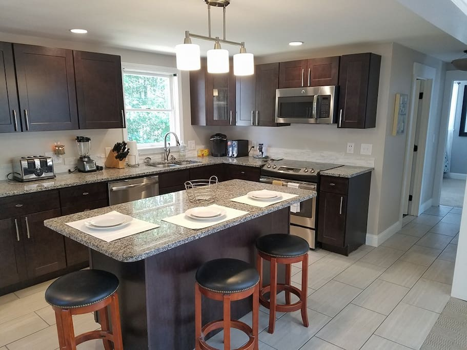 All new kitchen w/ maple cabinets, granite counter tops, and stainless steel applianes