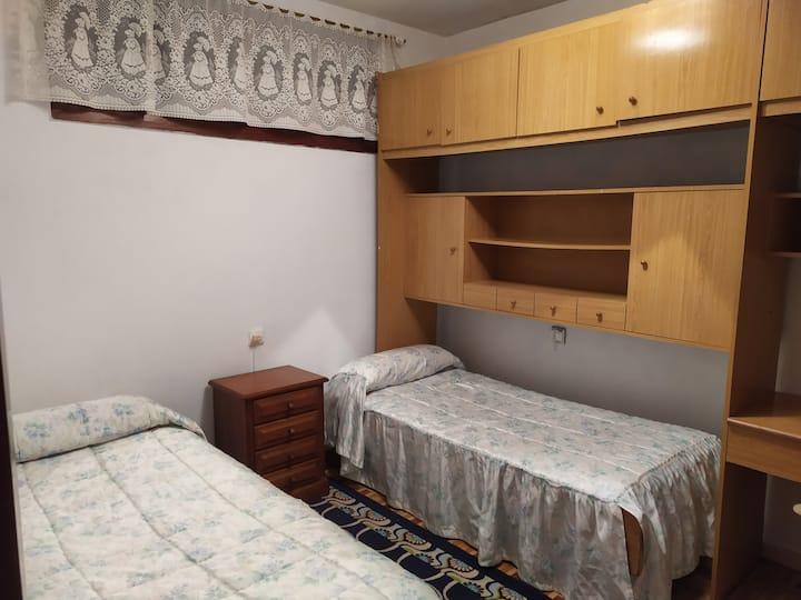 Habitación con 2 camas invididuales