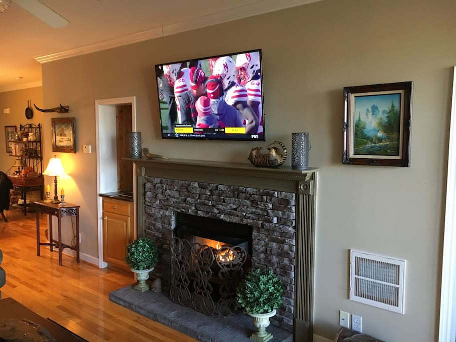 "Sit by the fireplace and catch your favorite sporting event on the 55"" Smart TV."