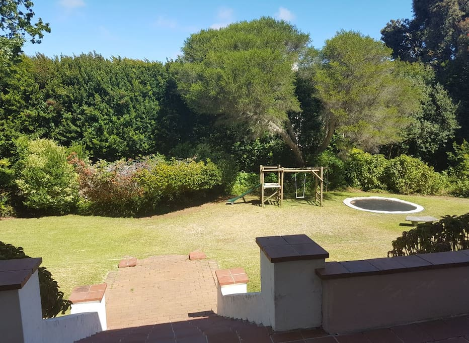 Large back garden from back patio with jungle-gym & trampoline