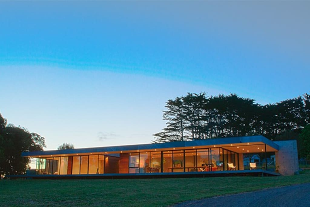 Cypress Hill - a modern home with long lines and floor to ceiling glass set on an acre block.