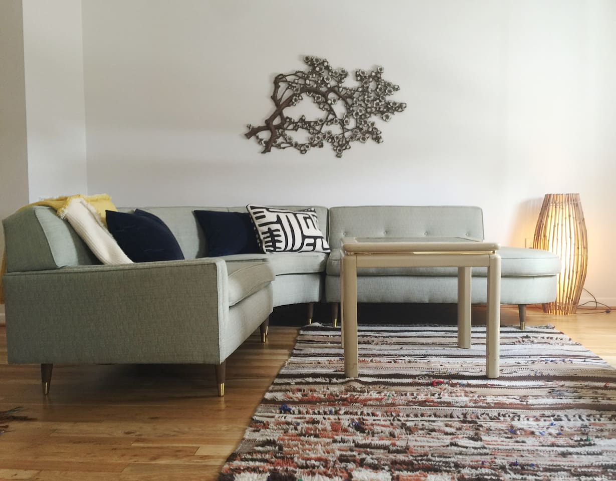 A 50's Sectional pairs with a Moroccan Rug