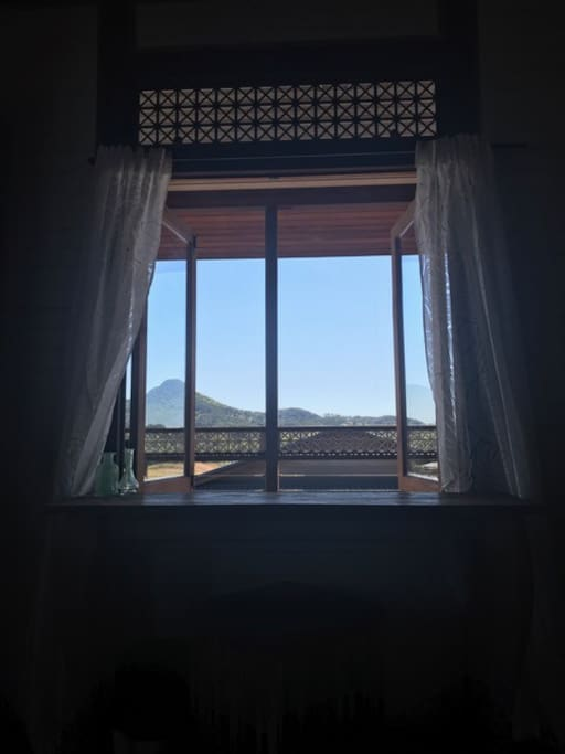 A desk by the window with a stunning view of My Chincogan