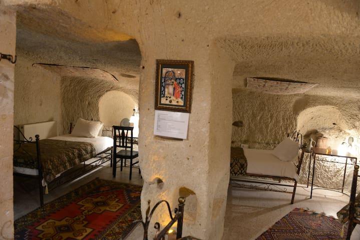 Caravanserai Cave Quad Room