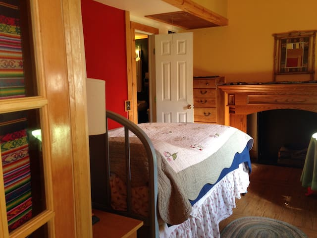 Main Bedroom. Enter through French doors. Double bed, Attached full bathroom, Table and Chair, Dresser, Wardrobe. A/C.