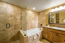 Master Spa Bath with beautiful glass shower and jetted tub.  Spa line of products all natural shampoo, conditioner, body wash, lotion and soaps.  Relax at your Mtn Getaway!