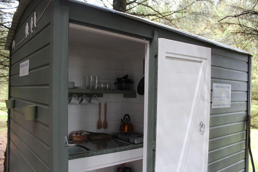 Kitchen, toilets and shower, tucked away in the woods in our shepherds hut.